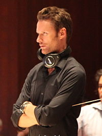 Brian Tyler. Source: Wikipedia