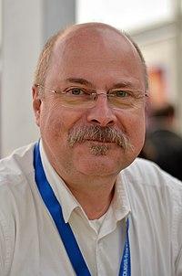 Serge Ernst. Source: Wikipedia
