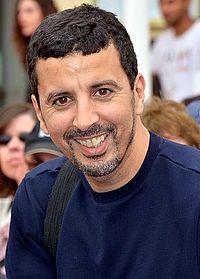 Samir Guesmi. Source: Wikipedia