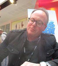 Tom McGrath. Source: Wikipedia